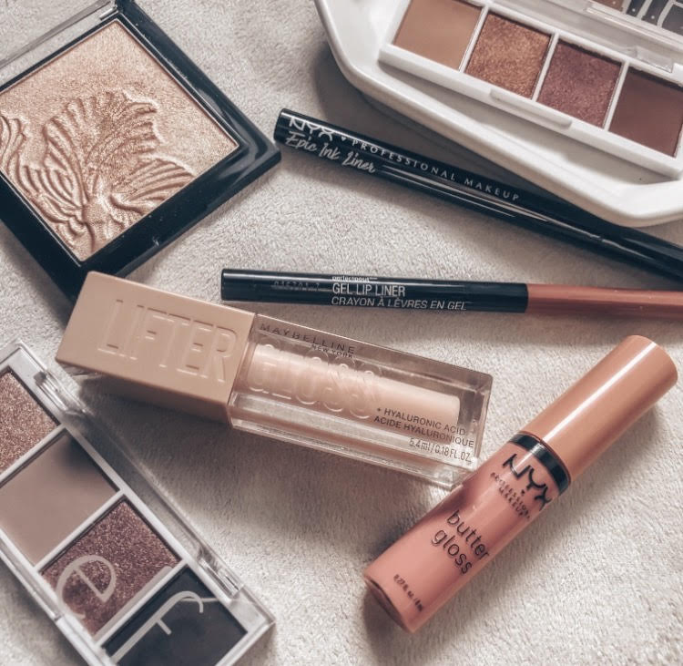 The best drugstore makeup products | a makeup flatlay featuring pink and neutral toned makeup products
